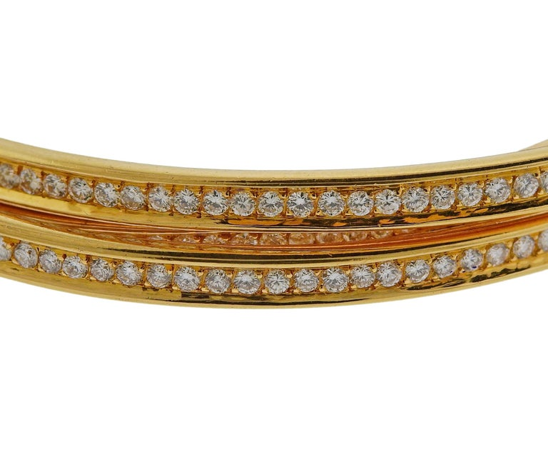 Cartier Trinity Diamond Gold Rolling Bangle Bracelet In Excellent Condition For Sale In New York, NY