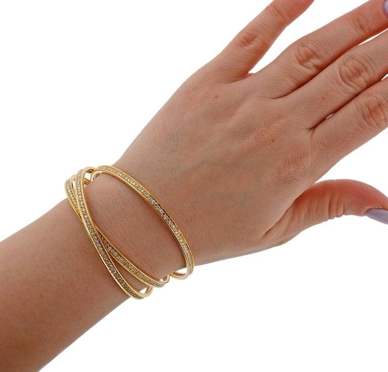 Women's Cartier Trinity Diamond Gold Rolling Bangle Bracelet For Sale