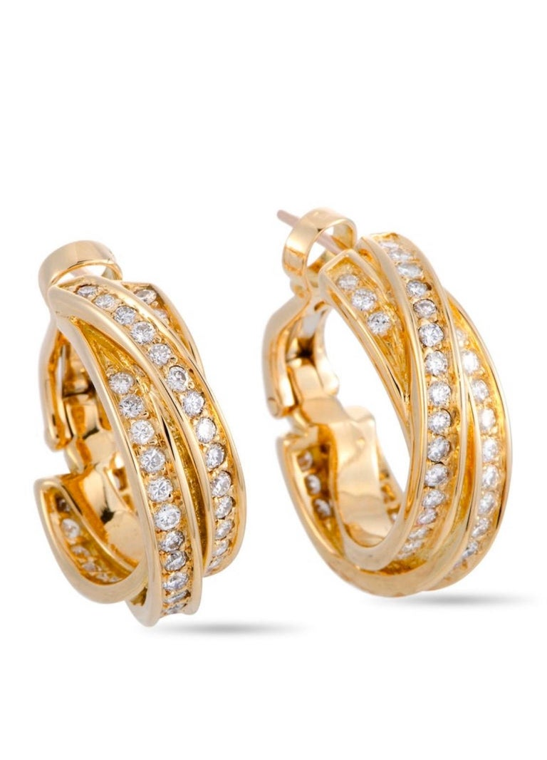 """The Cartier """"Trinity"""" earrings are made out of 18K yellow gold and diamonds and each of the two earrings weighs 7.35 grams, measuring 0.81"""" in length and 0.25"""" in width."""