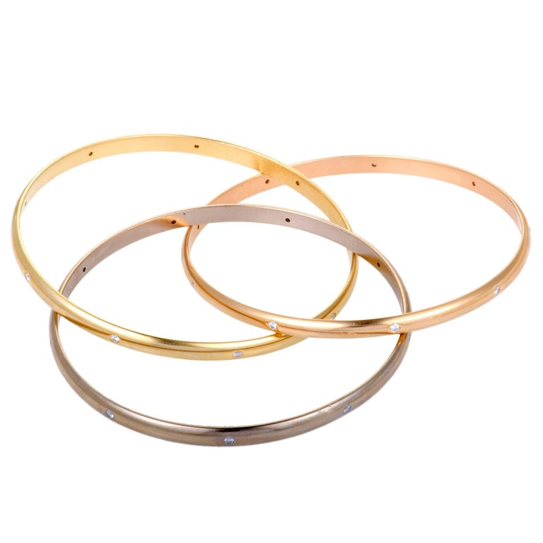 This gorgeous Cartier Trinity bangle bracelet is designed in the brand's renowned fashion and offers a look that combines eye-catching style with timeless elegance. Each bangle is crafted from either 18K white, 18K yellow or 18K rose gold, and is