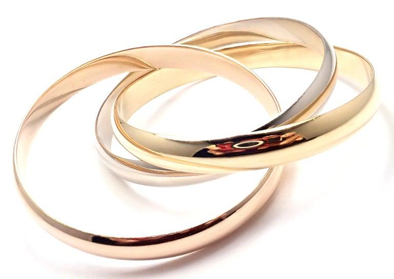 18k Tricolor Gold Diamond Large Model Medium Size Trinity Bangle Bracelet by Cartier.  Details: Length: 6.5