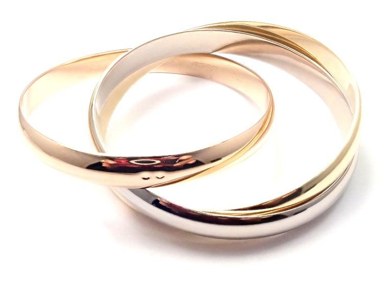 Women's or Men's Cartier Trinity Rolling Large Model Tricolor Gold Medium Size Bangle Bracelet For Sale