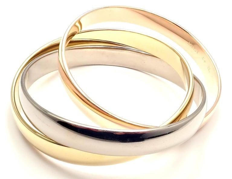 18k Tricolor Gold Diamond Large Model Small Size Trinity Bangle Bracelet by Cartier.  Details: Length: 6