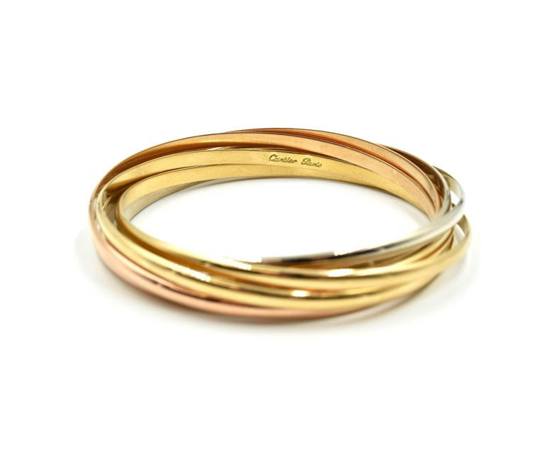 Designer: Cartier Collection: Trinity Material: 18k yellow, rose and white gold Dimensions: Trinity bracelets will fit up to 7 ¼ inch wrist Weight: 69.32 grams
