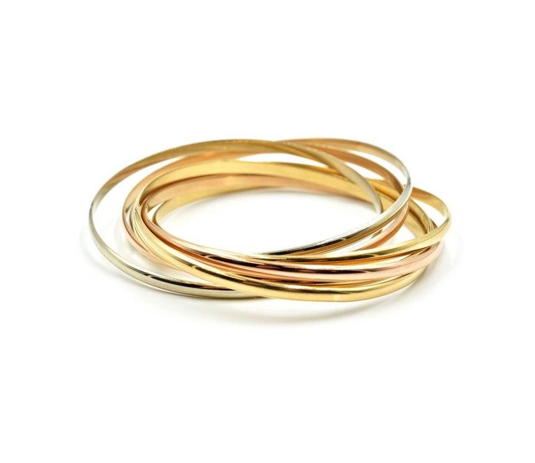 Cartier Trinity Seven Bangles Bracelet Tri-Tone 18 Karat Gold In Excellent Condition For Sale In Scottsdale, AZ