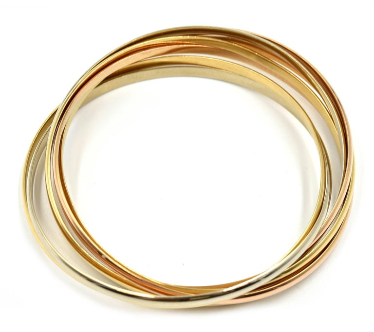 Women's Cartier Trinity Seven Bangles Bracelet Tri-Tone 18 Karat Gold For Sale