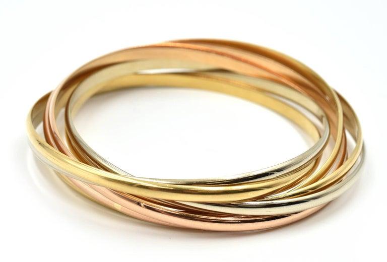 Cartier Trinity Seven Bangles Bracelet Tri-Tone 18 Karat Gold For Sale 1