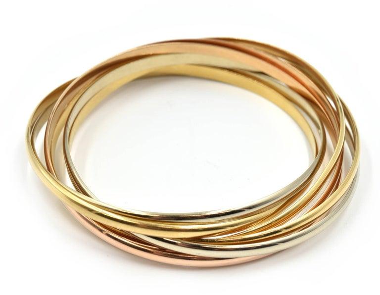 Cartier Trinity Seven Bangles Bracelet Tri-Tone 18 Karat Gold For Sale 2