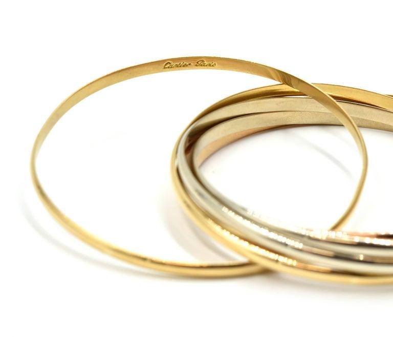 Cartier Trinity Seven Bangles Bracelet Tri-Tone 18 Karat Gold For Sale 3