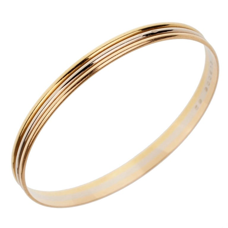 An iconic Cartier trinity slip on bangle in 18k yellow, rose and white gold.