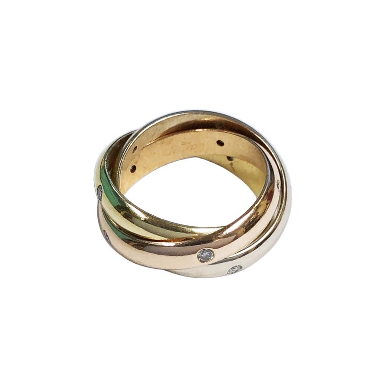 Circa 2000 Cartier Trinity collection Triple Band Ring, 18K Yellow, White and Rose Gold, each band measuring 3.5 M.M. wide and each is set with 5 Round Brilliant cut Diamonds totaling 1.2 Carat for all 3 Bands. Finger size = 5 1/2. Comes in original