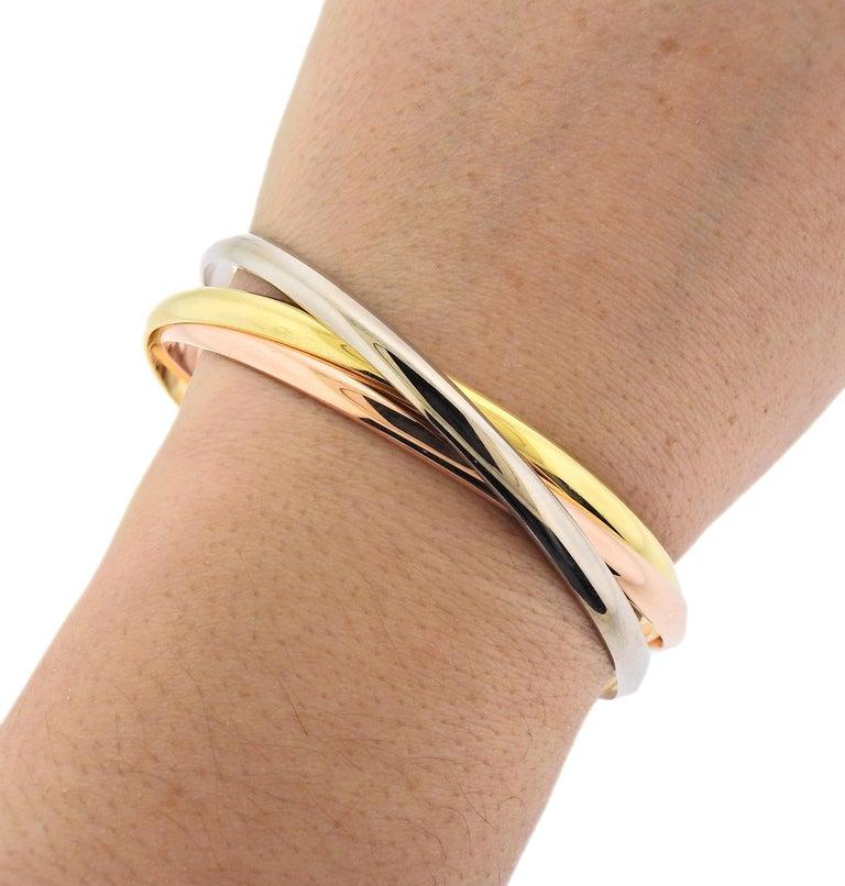 Women's Cartier Trinity Tri Color Gold Rolling Bangle Bracelet For Sale
