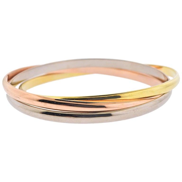 Cartier Trinity Tri Color Gold Rolling Bangle Bracelet For Sale