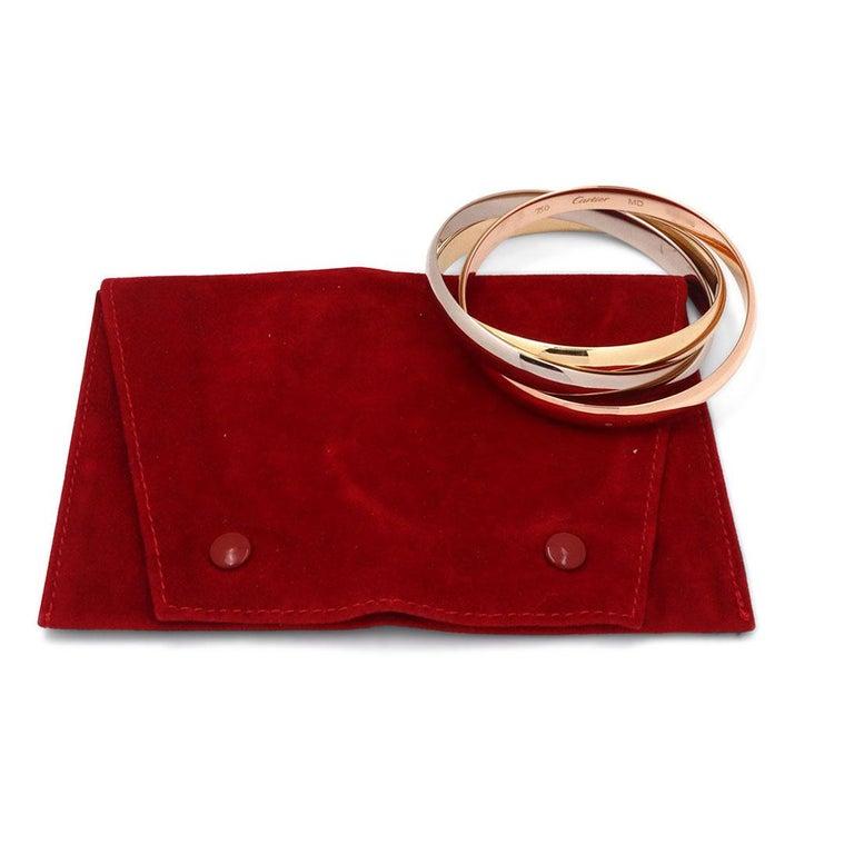 Women's or Men's Cartier Trinity Tri-Color Gold Rolling Bracelet For Sale