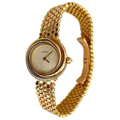 Cartier, Trinity Watch in 18 Karat Gold 33 Diamonds and a 18 Karat Gold Bracelet