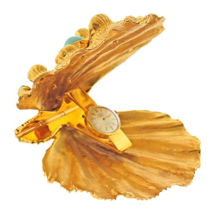 Exquisite and one of a kind, vintage Cartier shell travel watch. The shell is adorned with turquoise. Measures 4
