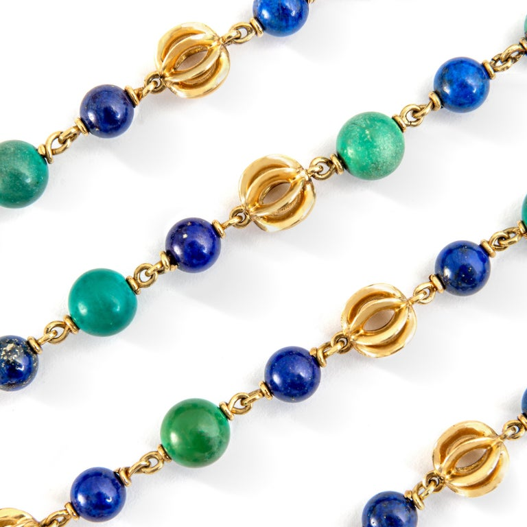 Turquoise and Lapis Lazuli beads alternating yellow gold 18k designed elements compose this Sautoir Necklace. Signed Cartier. Maker's mark, Numbered.  Circa 1970. Total length: 35.43 inches (90.00 centimeters).