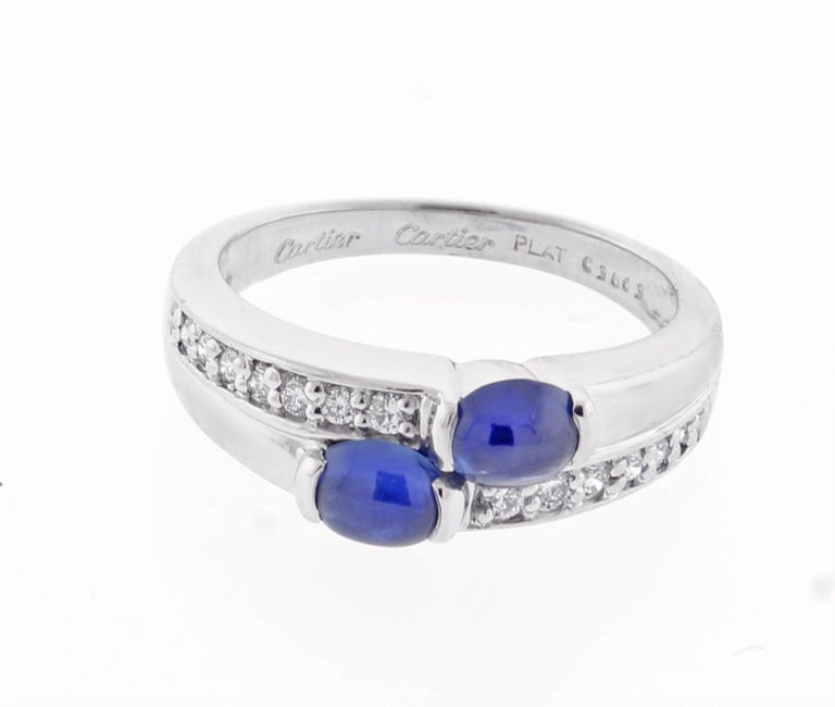 ♦ Designer: Cartier ♦ Metal:Platinum ♦ Gem stone: 16 Diamonds=.25 carats ♦ Gem stone: 2 Sapphires=.85 carats ♦ Circa 1995 ♦ Size 6½, Resizable Limited ♦ Packaging:Cartier Boxes ♦ Condition: Excellent , pre-owned ♦ Price: Based on the market, prices
