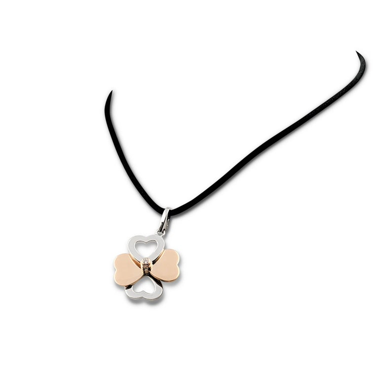 Round Cut Cartier Two-Tone Gold and Diamond Spinning Heart Clover Pendant Necklace For Sale
