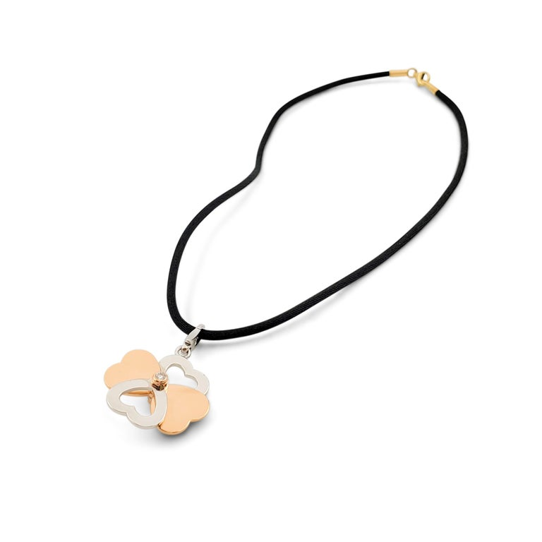 Women's or Men's Cartier Two-Tone Gold and Diamond Spinning Heart Clover Pendant Necklace For Sale