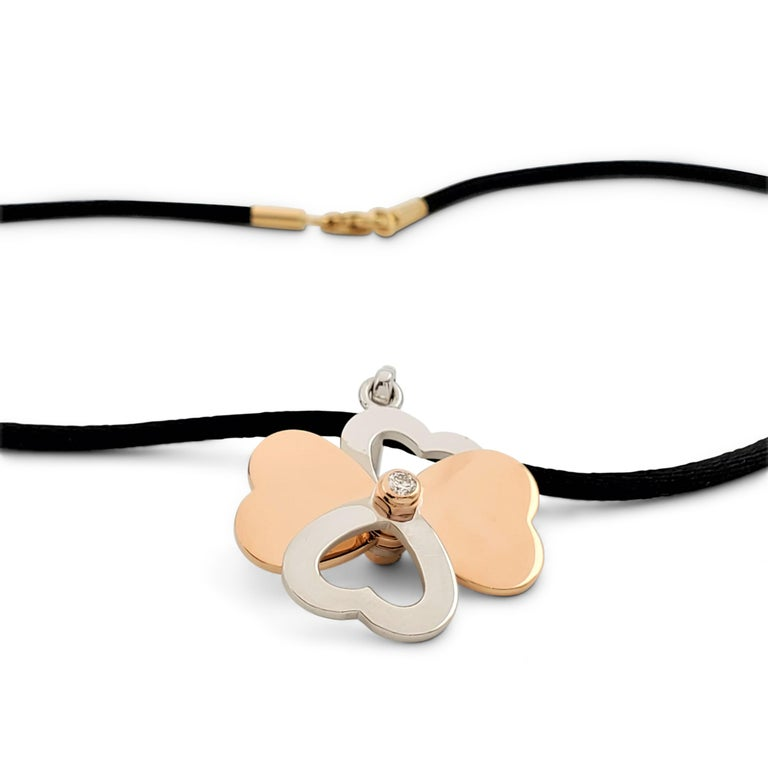Cartier Two-Tone Gold and Diamond Spinning Heart Clover Pendant Necklace For Sale 1