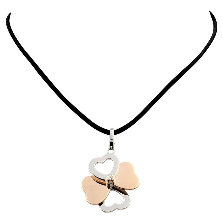 Cartier Two-Tone Gold and Diamond Spinning Heart Clover Pendant Necklace For Sale