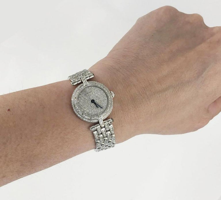 CARTIER Vendome 23mm Diamond Watch in 18k White Gold.  A classic Vendome watch by Cartier featuring a full diamond pave face surrounded by a bezel and band, mounted in 18k white gold. Watch strap doubles as a bracelet, with links of diamonds