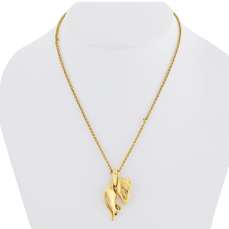 Yellow gold vintage Panthere pendant on a signature Cartier chain. 18k yellow gold panthere is an exemplary representative of the house of Cartier. It is in excellent condition. This piece is highly collectible and a very rare. The pendant is fully