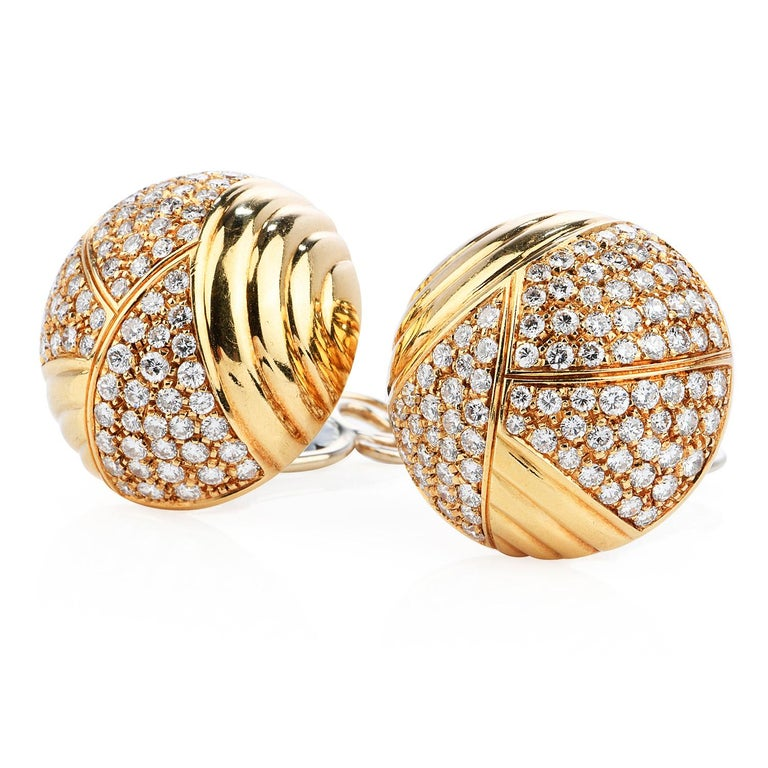 Vintage Cartier from mid-80s to early 90s, cluster dome clip on earrings, made for a sophisticated retro look,  Crafted in 18K yellow gold, the piece is enhanced by Pave set round cut Diamonds weighing approximately 6.10 carats (F-G color and VVS