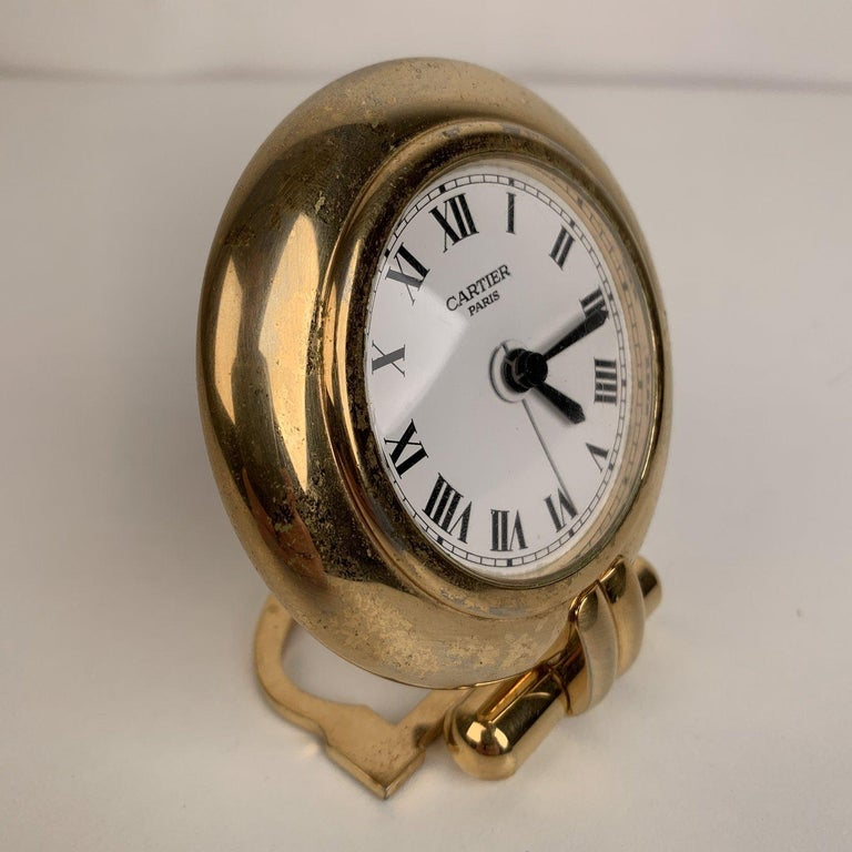 MATERIAL: Metal COLOR: Gold MODEL: Table clock GENDER: Women, Men SIZE: 3.25 x 3.25 inches - 8.9 x 8.9 cm Condition B - VERY GOOD Working condition. New Battery freshly installed. Light surface scratches on metal due to normal use. - Internal Ref: -