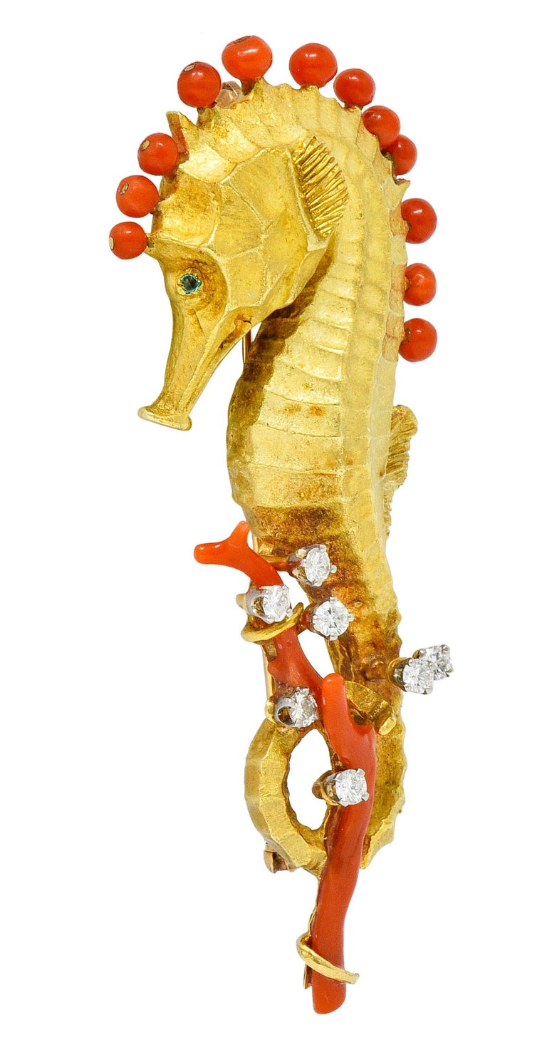 Brooch is designed as a highly rendered matte gold seahorse  With 2.5 to 3.5 mm round bead coral along spine and two branches of coral intertwined with tail  Coral is a very well-matched orangey-red color and is in very good condition  With round