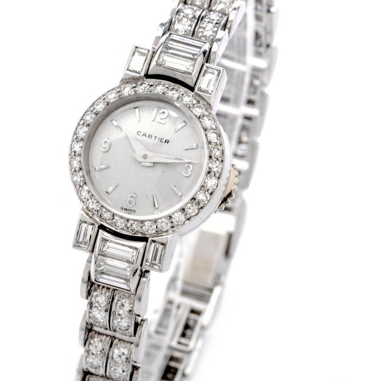 Designer: Cartier  Collection: Vintage  Gender: Ladies  Movement: Winding  Case Material: Platinum  Case Diameter approx: 16mm  Dial Color: Silver Gray  Crystal: Sapphire  Diamonds: 108 round cut diamonds approx. 4.00cttw, 10 baguette cut diamonds