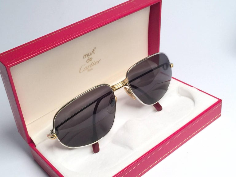 Vintage Cartier Romance Vendome Platinum sunglasses with G15 grey (uv protection)lenses.  Frame is with the front and sides in yellow and white gold. All hallmarks. Red enamel with Cartier gold signs on the ear paddles. Both arms sport the C from