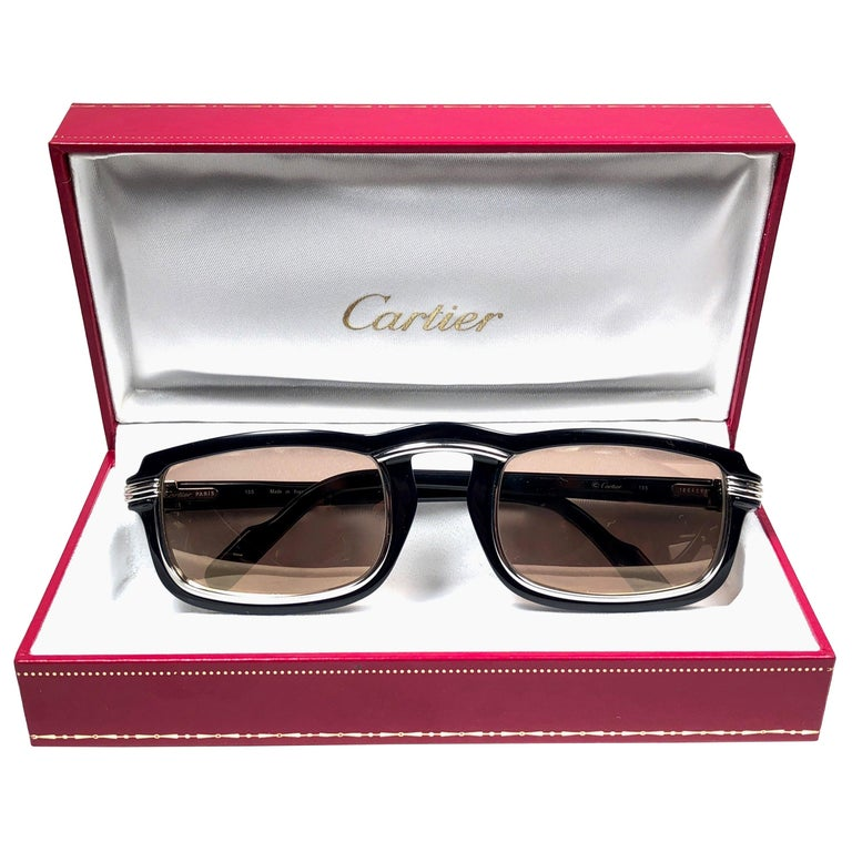 1991 Original Cartier Vertigo Art Deco Sunglasses with spotless amazing brown medium lenses (uv protection).  Frame has the famous platinum accents in the middle and on the sides. All hallmarks. Cartier signs on the earpaddles. Both arms sport the C