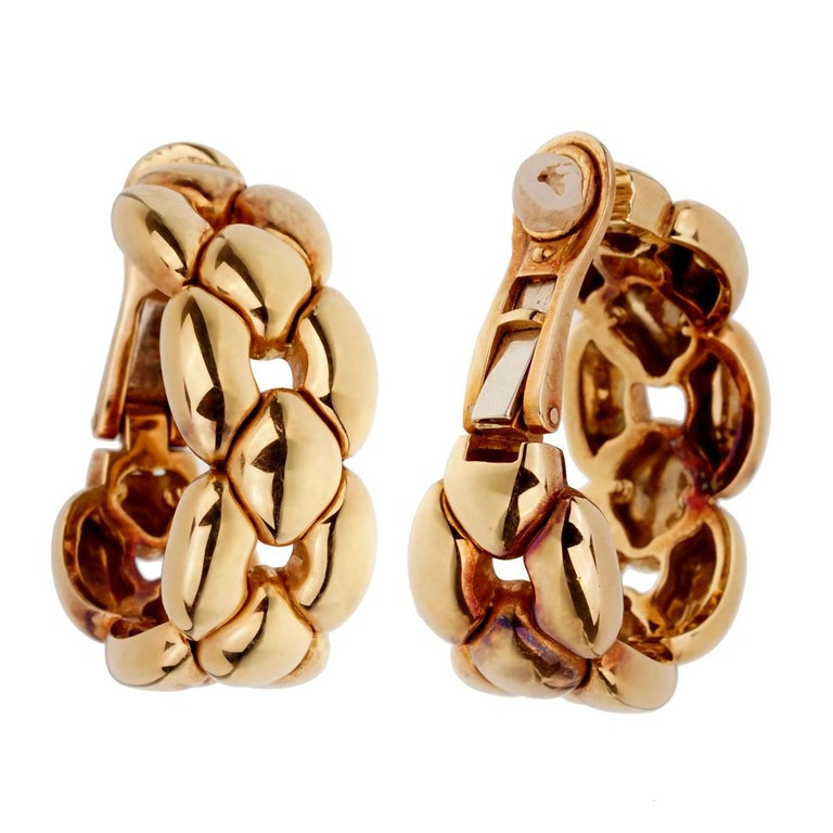 A magnificent set of Cartier hoop earrings crafted in 18k yellow gold. The earrings measure .50
