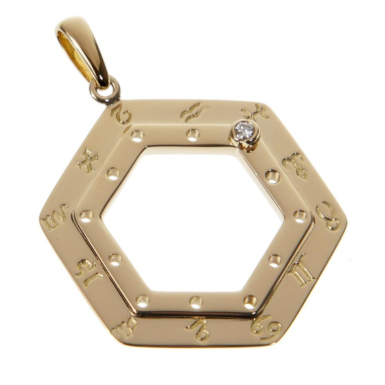A fabulous vintage Cartier zodiac pendant, the pendant showcases all 12 zodiac signs and diamond screw which can be placed on your zodiac sign of choice. The pendant is crafted in 18k yellow gold and measures 1.57