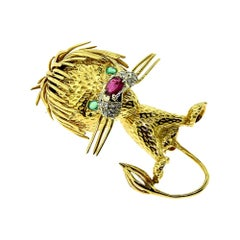 Cartier 'Whimsical Lion' Diamond, Ruby and Emerald Gold Brooch Pin