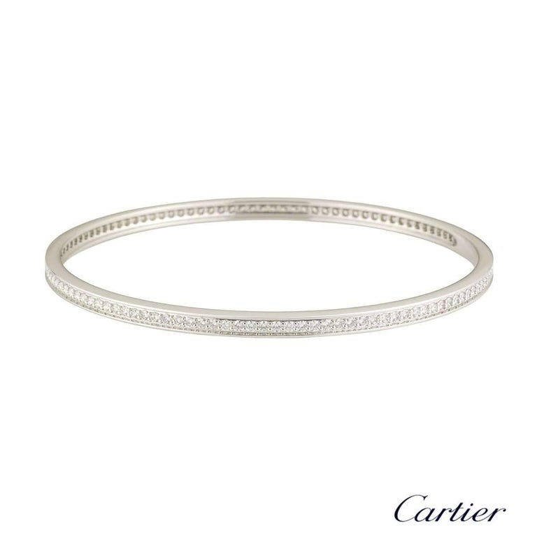 A stunning 18k white gold Cartier diamond bangle. The bangle comprises of a full pave set with 116 round brilliant cut diamonds with a total weight of approximately 2.90ct, F colour and VS clarity. The bangle fits a wrist up to 20.25cm and has a