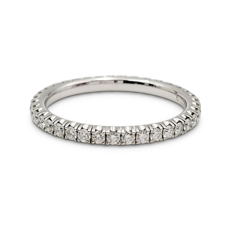 Authentic Cartier eternity band crafted in 18 karat white gold and set with an estimated 0.40 carats of round brilliant cut diamonds (E-F, VS). Signed Cartier, Au750, with serial number. Ring size 5 1/2. The band is presented with the original box