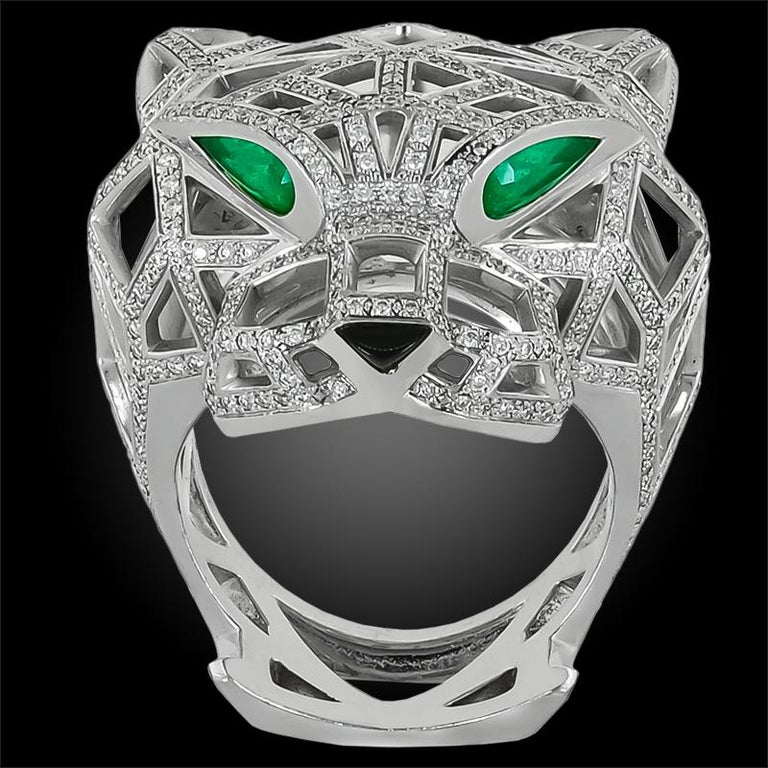 18k white gold diamond, emerald and onyx Panthere de Cartier ring, with French hallmarks.  Size 65