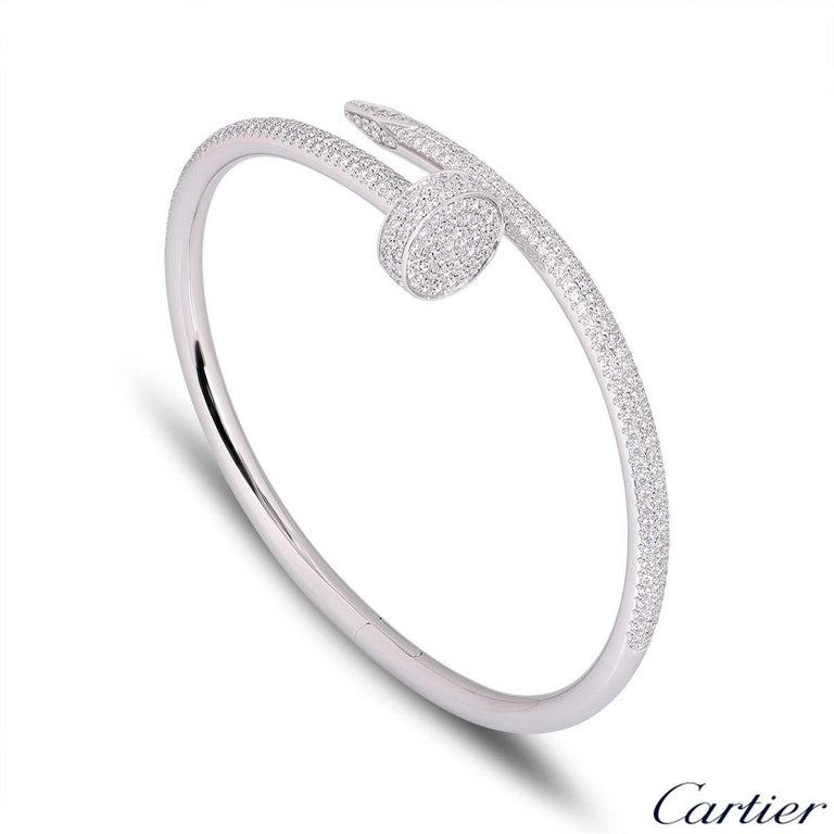 A stunning 18k white gold diamond bangle by Cartier from the Juste Un Clou collection. The bangle is of a nail design, fully pave set around the outer side with 374 round brilliant cut diamonds totalling 2.26ct. The bangle is a size 17 and has the