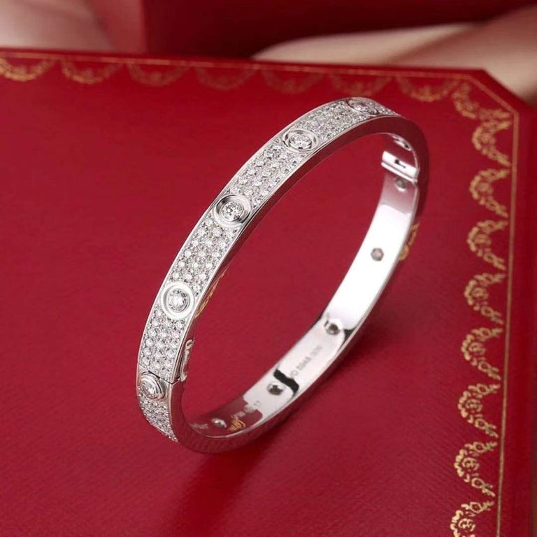 18K white gold, set with 216 brilliant-cut diamonds totalling 3.15 carats.With a jaw-dropping Vvs1 Clarity E-F Color Diamonds gracing the entirety of its length, this 18k white gold Cartier Love Bracelet is captivating to a degree that almost defies