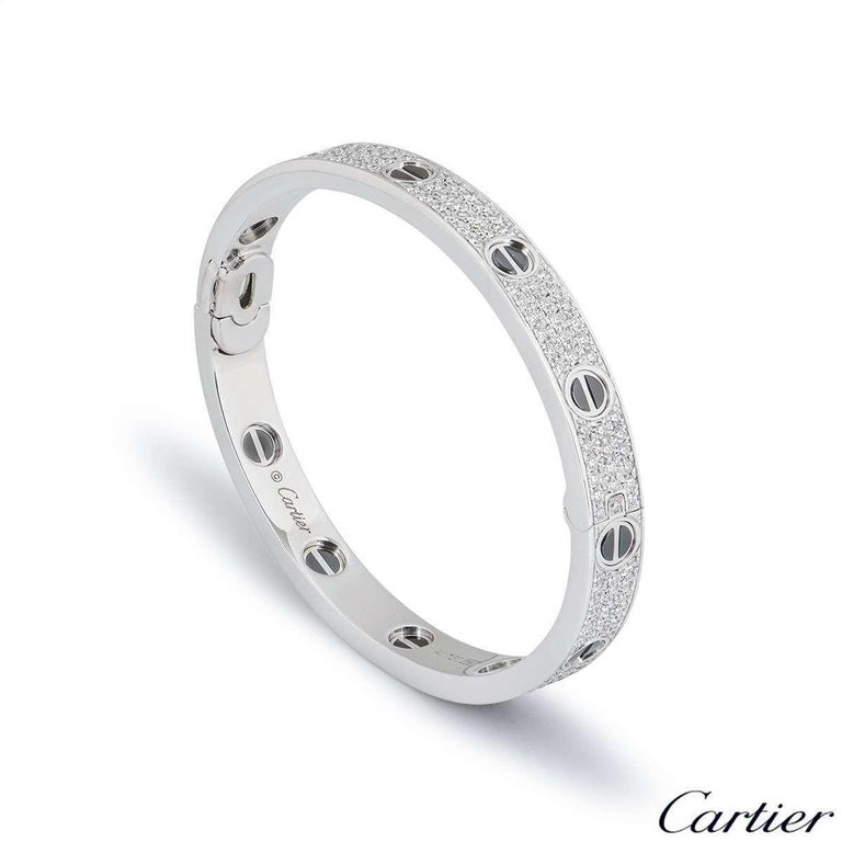 A stunning 18k white gold diamond and ceramic bracelet by Cartier from the Love collection. The bracelet has black ceramic set to the iconic screw motifs around the outer edge with 204 round brilliant cut diamonds pave set between the screws. The