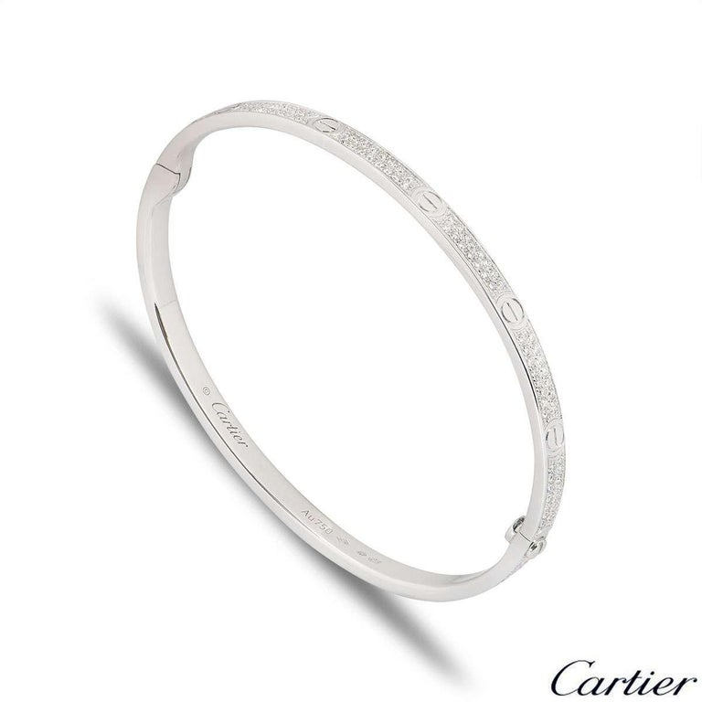 A sparkly 18k white gold diamond Cartier bracelet from the Love collection. The bracelet comprises of the iconic screw motifs around the outer edge complemented with 177 round brilliant cut pave set diamonds in between. The diamonds have a total