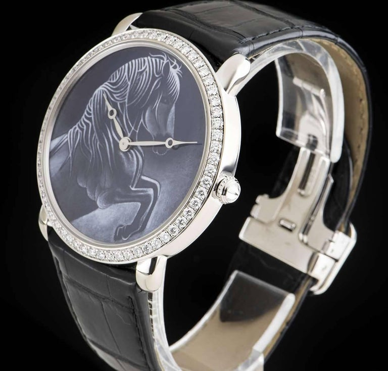 An 18k White Gold d'Art Chinese Year Of The Horse Limited Edition Ronde Louise XL Gents Wristwatch, blue grisaille enamel dial with horse motif, a fixed 18k white gold bezel set with approximately 60 round brilliant cut diamonds, crown set with a
