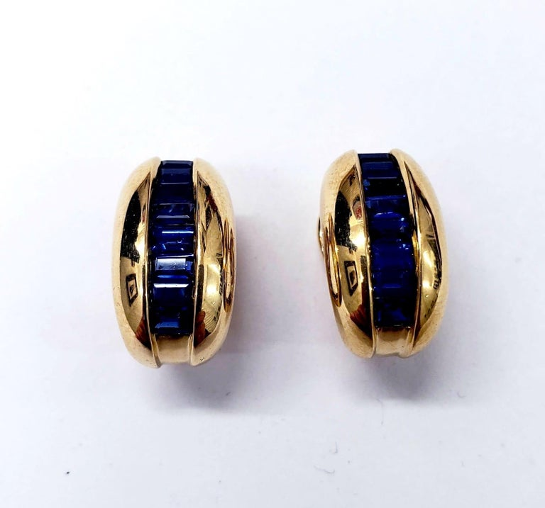 Cartier Yellow Gold Bombe Bean 1.50ct Blue Sapphire Earrings. The total carats weights approx 1.50ct. The earrings are made of 18k solid yellow gold. The earrings weight 12.8 grams. Features post and hinge clip fittings. Measures 10.3mm X 18mm.