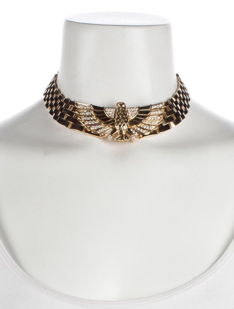 Simply stunning!  The flexible, polished brick-link collar, set to the front with a chased falcon motif and pave-set brilliant-cut diamond detail, with concealed clasp.  Decorated with 'Horus', the Egyptian God represented as a falcon, and