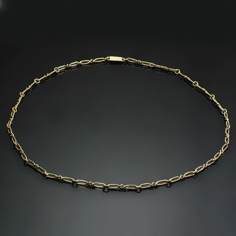 This unisex vintage Cartier necklace features a classic long open link chain design crafted in 18k yellow gold. Made in France circa 1970s. Measurements: 0.15