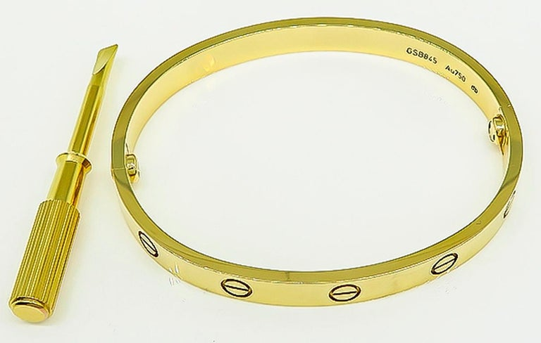 This classic Cartier 18k yellow gold love bangle has a width of 6mm and it weighs 33 grams. The size of the bangle is size 17. It is signed Cartier 17 GSB845 Au750.   Inventory #17539WKSS