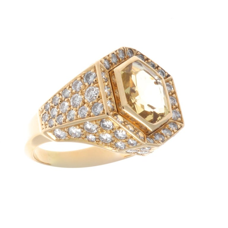 Cartier's never ending journey of excellence. Featuring an approximately 3.50 carat yellow sapphire that has not been heated and is crowned by a tiara of diamonds. Crafted in 18k yellow gold. Signed Cartier and numbered. Ring size 6-1/4 and can